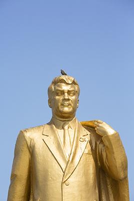 Pigeon on head of Statue of the Turkmenbashi President Niyazov, Ashgabat, Turkmenistan