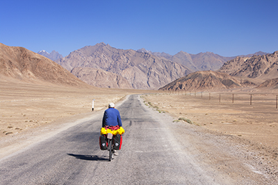 Cyclist on the Pamir Highway, Tajikistan